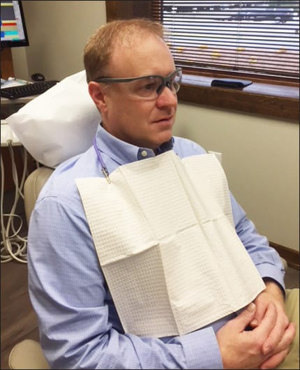 dental patient wearing safety goggles.