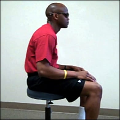 Image of slouched sitting.