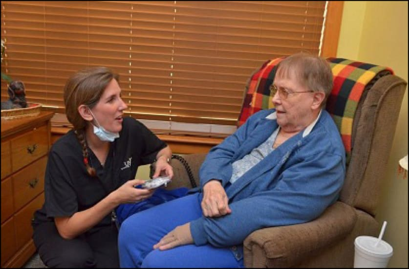 Photo of delivering care where people live is an example of care in a community-based setting.