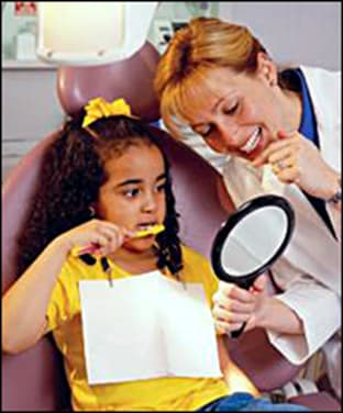dentist helping young patient.