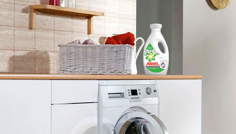 Ariel Matic Front Load Washing Liquid close to a laundry basket