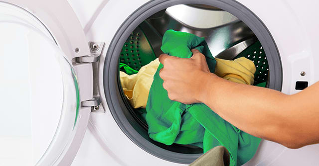 Loading colourful garments to a front load washing machine