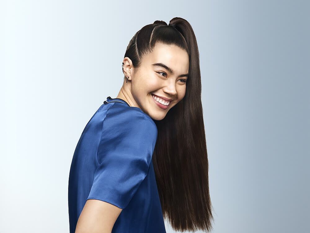 Young smiling woman with long ponytail