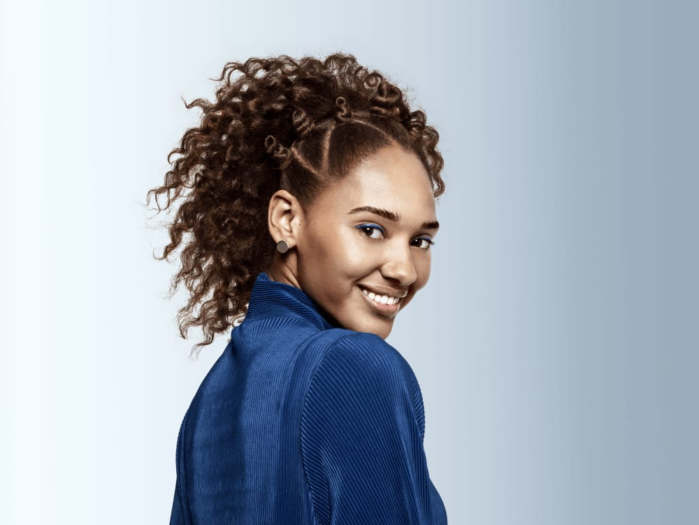 Young woman smiling with hair styled
