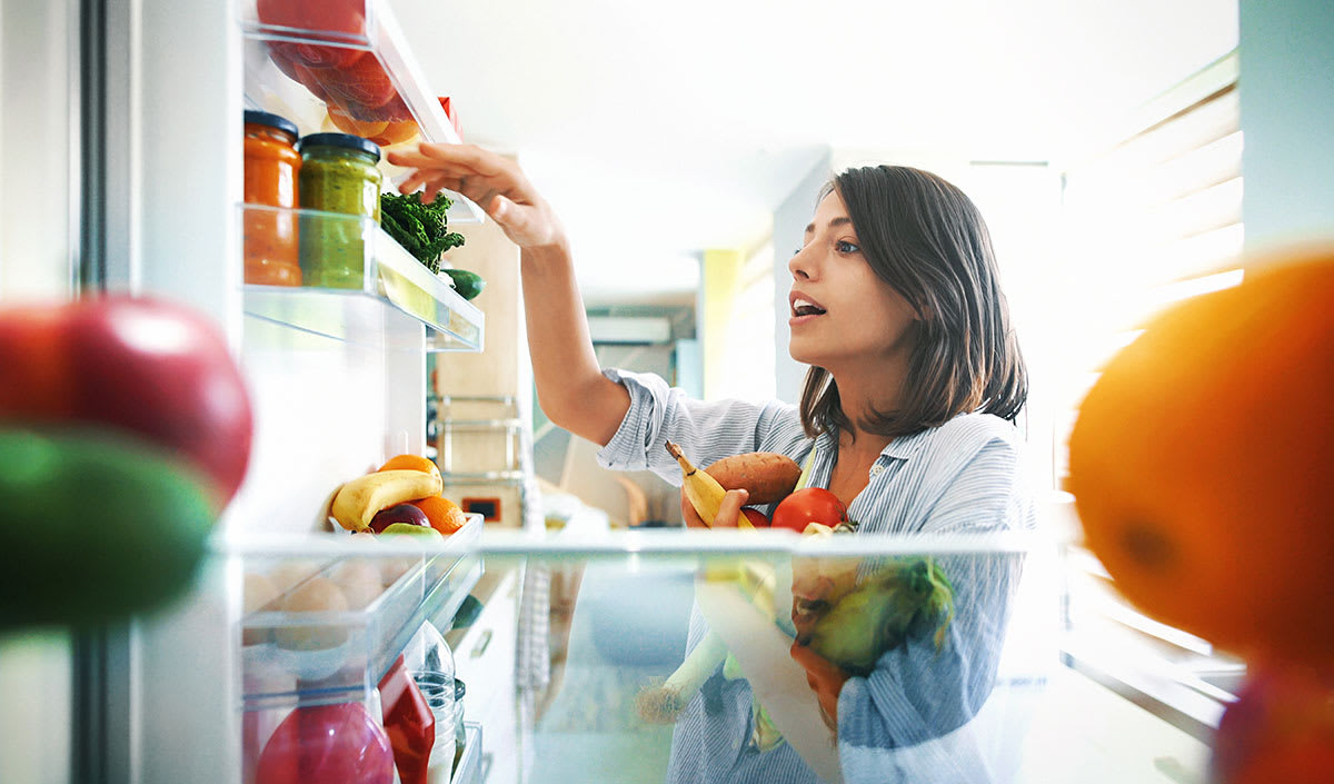 Woman looking at food on shelf