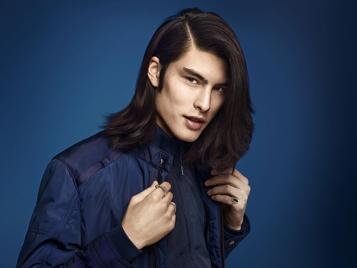 Man with black straight long hair