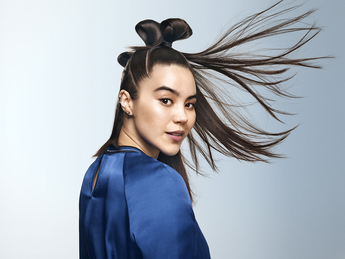 Woman with black straight hair in bun