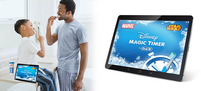 Father and Son Brushing Their Teeth Using Oral-B Disney Magic Timer App