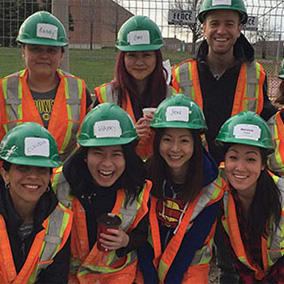 Group of people in hardhats and safety vests