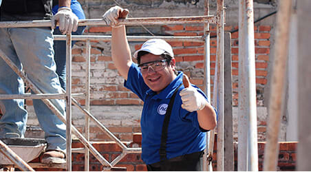 Builder gives a thumbs-up to the camera