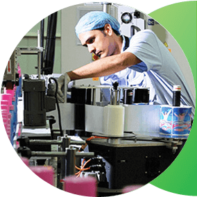 An employee oversees the production of laundry detergent bottles.