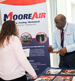 P&G-employee-learning-about-the-services-offered-by-Moore-Air