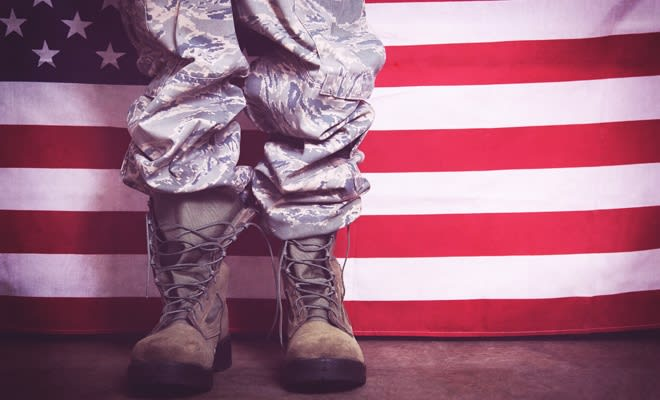 Military boots in front of the American Flag