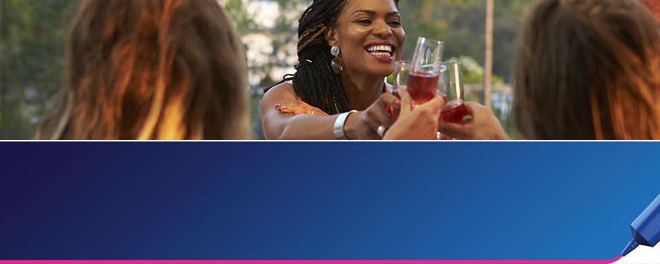 "A group of 30-something women toast in a garden party with the text ""Living with dentures"" on the banner. They know they can still have fun living with dentures with help from Fixodent."
