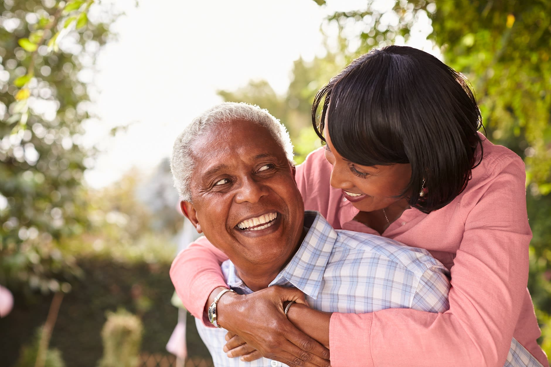 "A couple in their 50s are smiling confidently thanks to Fixodent discussing ""What are Immediate Dentures?"""