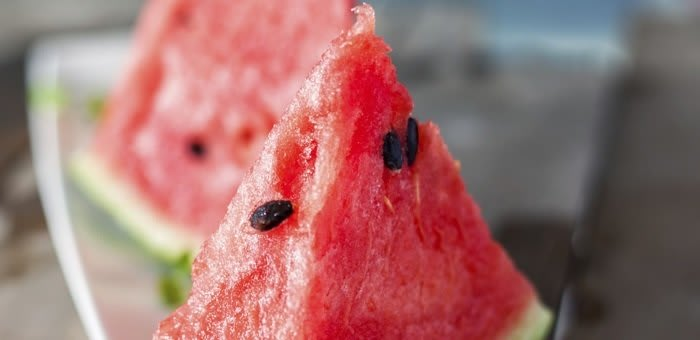 A close up of a slice of watermelon belonging to a denture wearer who knows it's important to get the right nutrition while wearing dentures, but can still eat anything while using Fixodent.