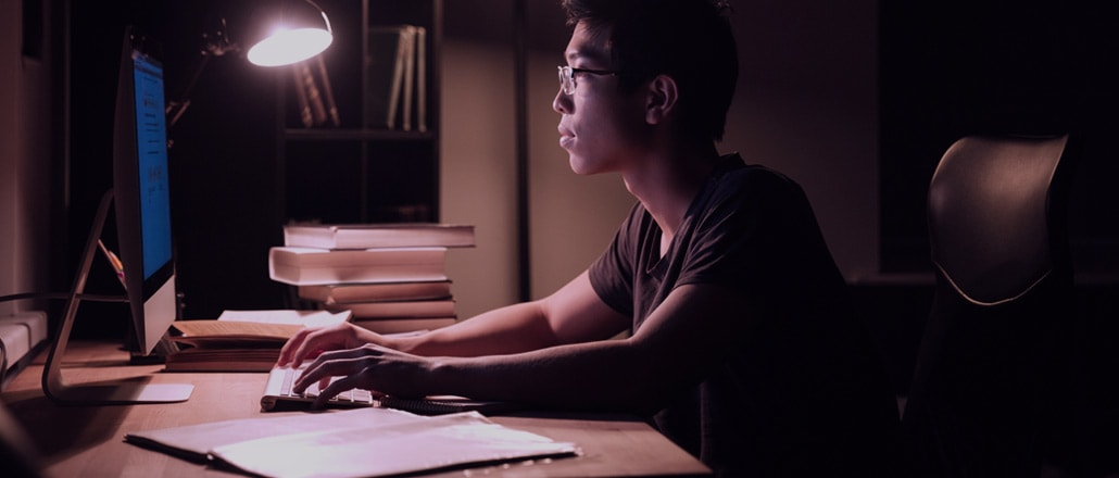 Student working all night to finish thesis