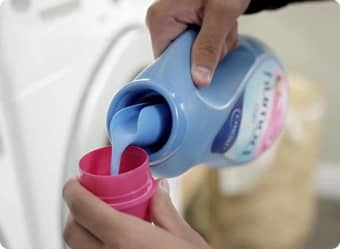 Measure the correct dose of Downy Fabric Conditioner.