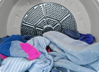 Catch the dryer as soon as it dings to avoid letting wrinkles set in.