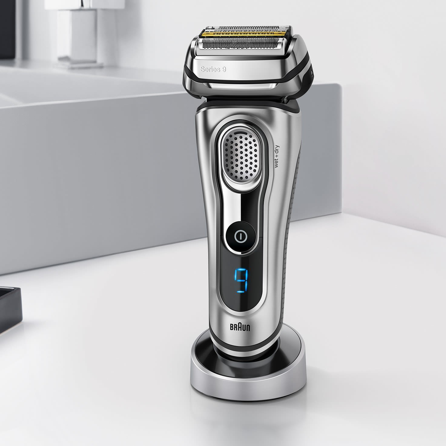 Braun Series 9 silver electric shaver with charging stand