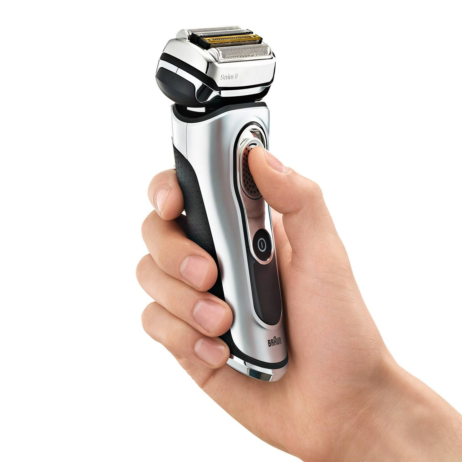 Braun Series 9 silver electric shaver in hand
