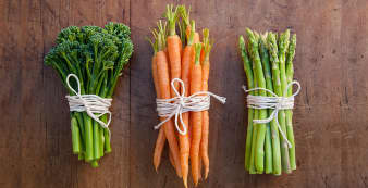High fiber foods like broccoli flowerets, carrots, and asparagus tied with strings into bunches