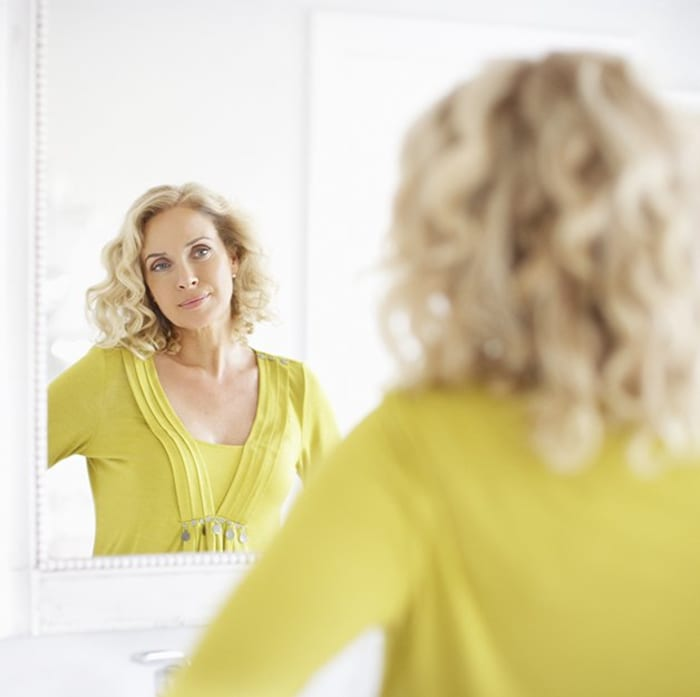 yellow dressed girl with curly hair
