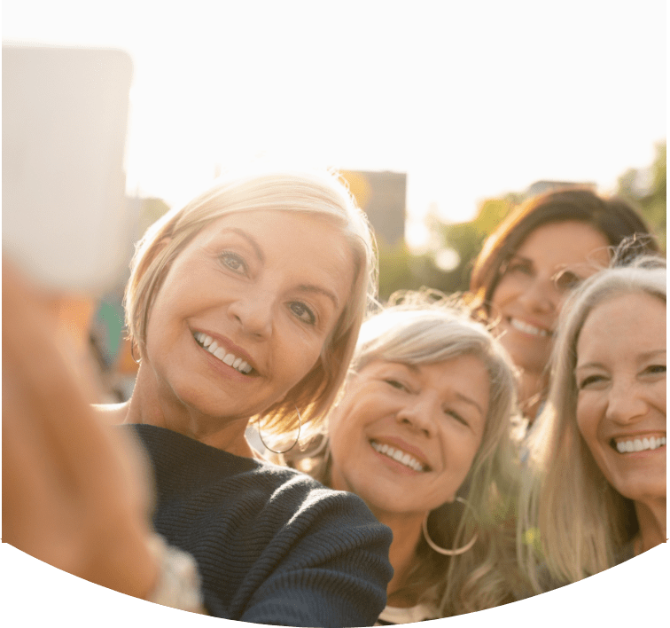 A group of smiling women taking a selfie