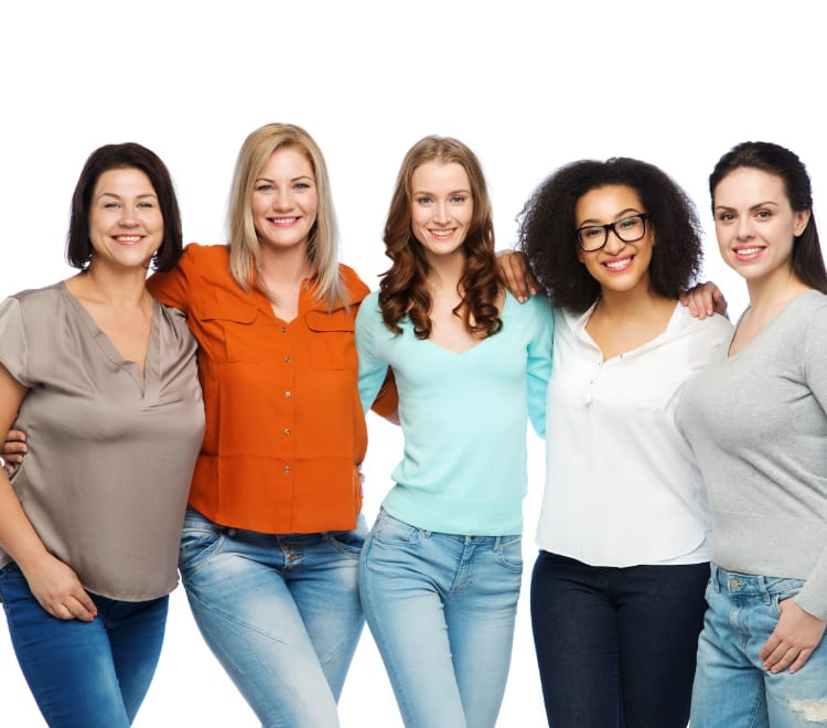 A group of confident women smiling for a photograph