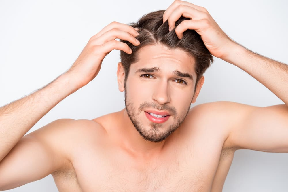 Dandruff In Men: How To Get Rid Of Dandruff Without Pulling Out Your Hair.