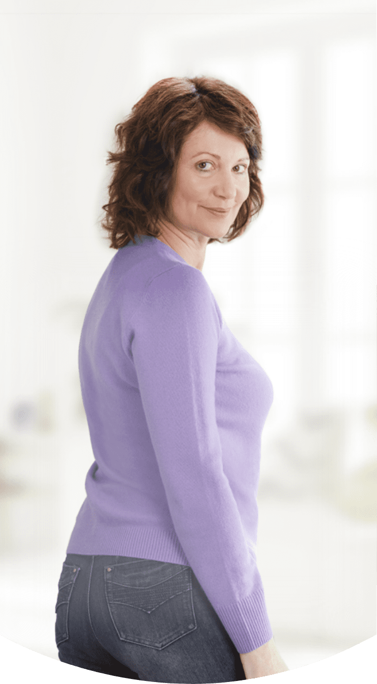 A woman in a purple shirt posing for a photograph