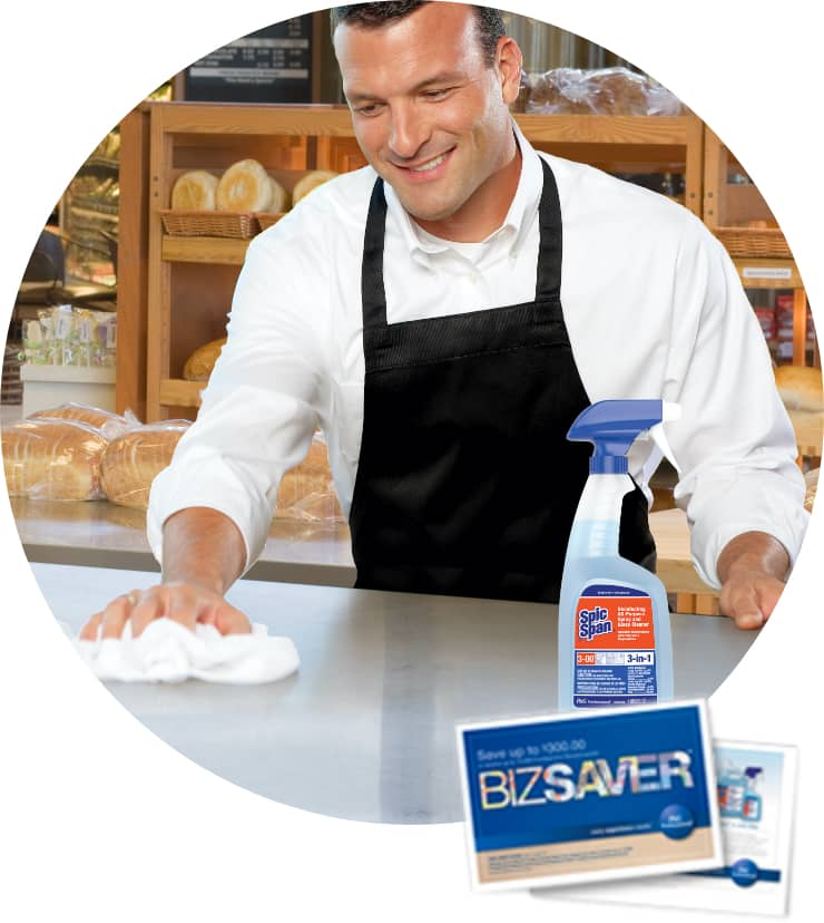 Man Cleaning kitchen with Spic and Span