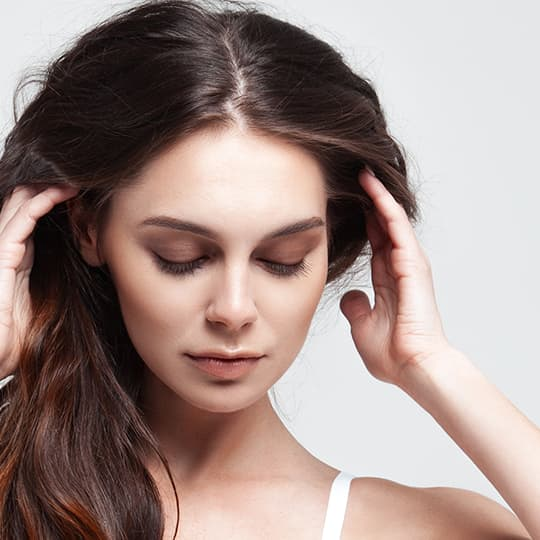 Woman holding her hair looking for solution