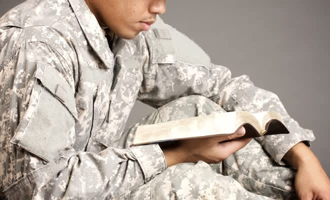 American Soldier reading a book