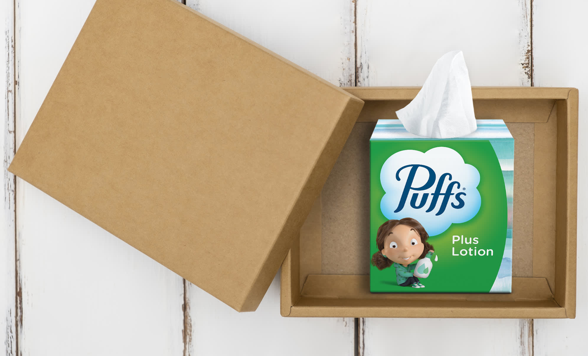 Puffs Plus Lotion box of tissues sitting on the table
