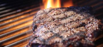 A Piece of Steak on a barbecue grill