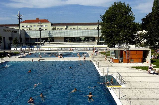 Two large outdoor pools at a sunny day in munich.