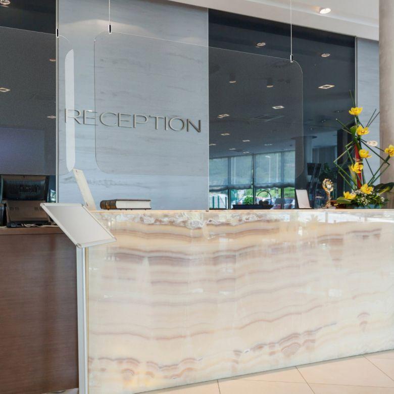 Suspended Sneeze Guard / Hygiene Screen Above Hotel Reception Desk