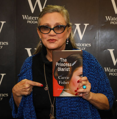 """Carrie Fisher Signs Copies Of Her New Book """"The Princess Diarist"""" At Waterstones Piccadilly"""