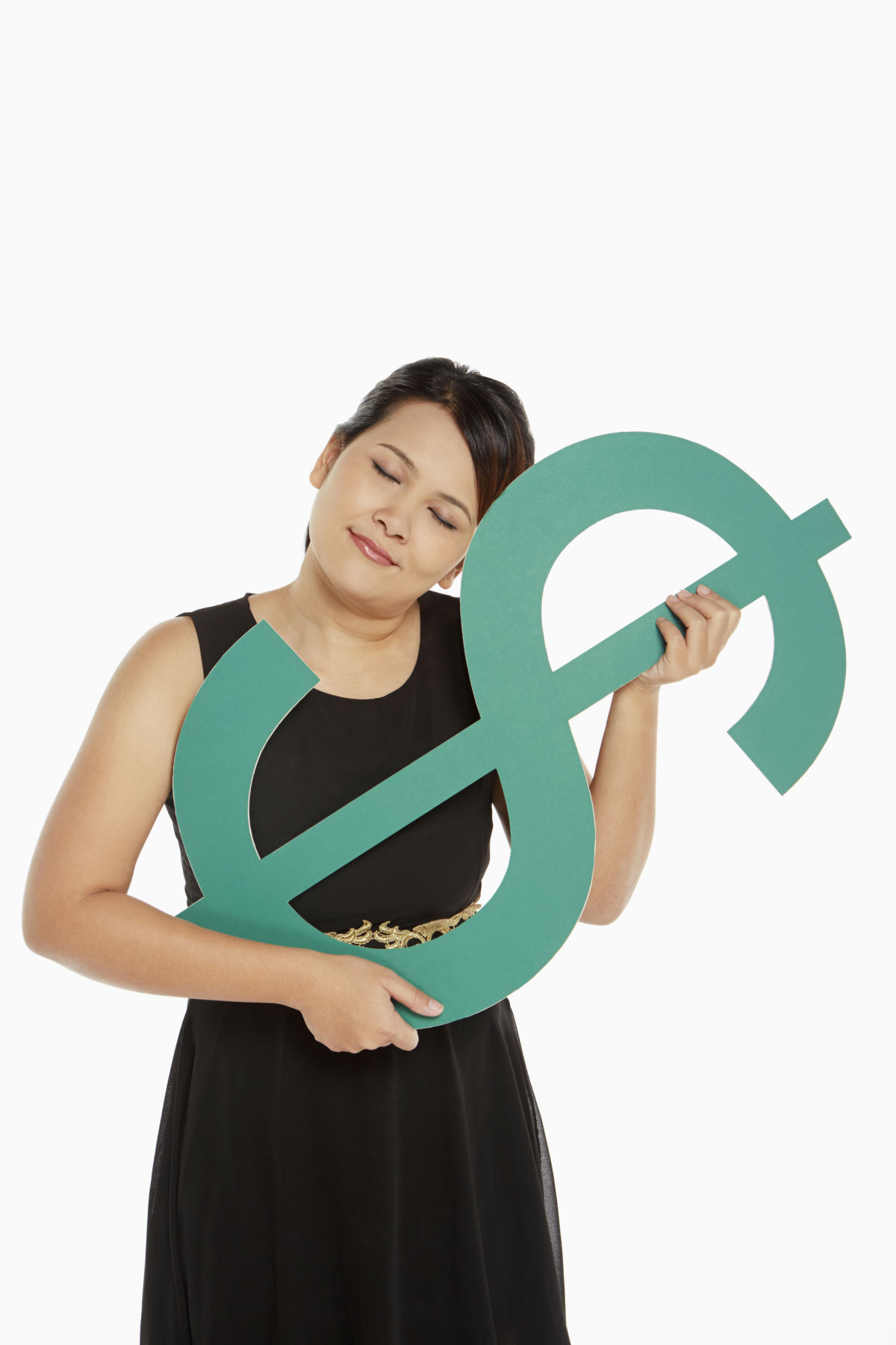 Woman laying her head on a dollar sign