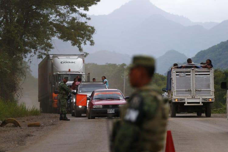 migrantes camiones