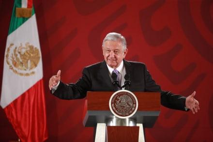 AMLO celebra reforma migratoria de Biden y suspensión del muro
