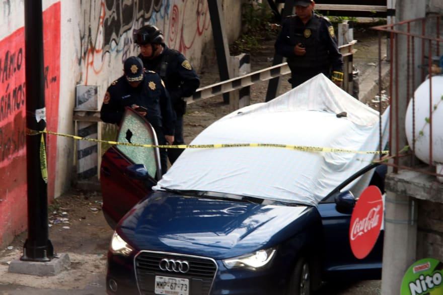 Acribillan a balazos a comerciante de autos y a su hija en un Audi