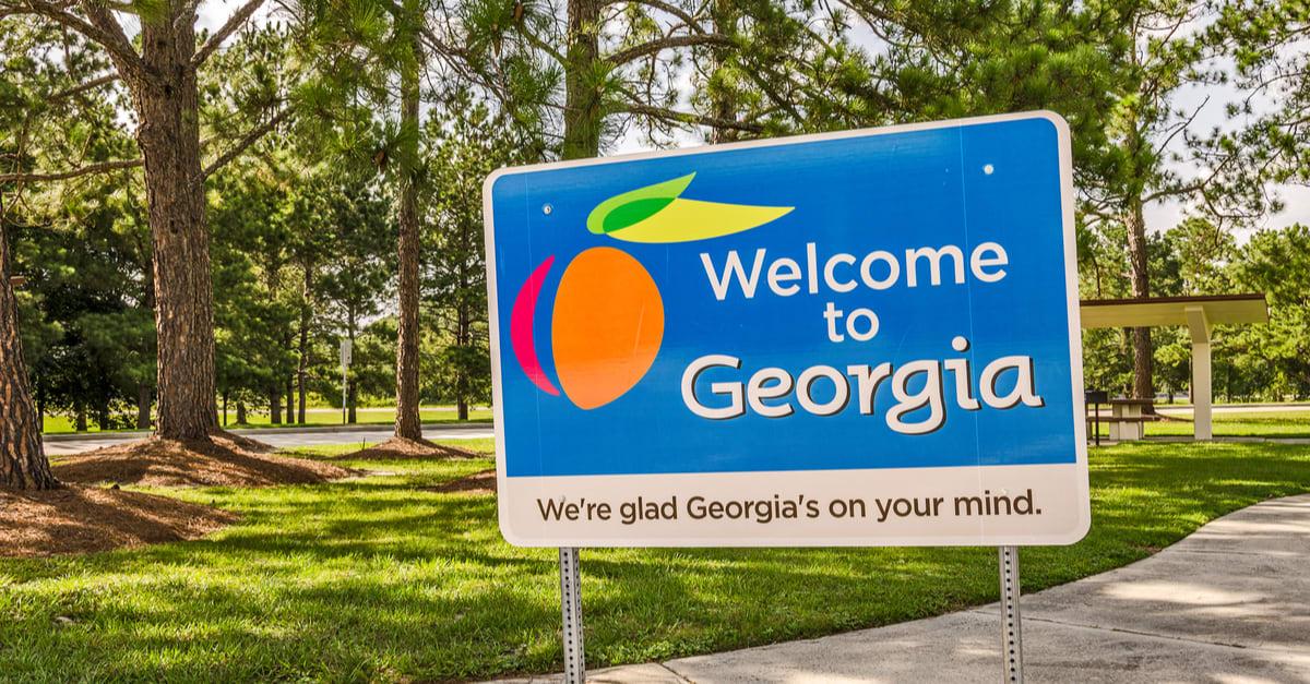 Cartel de Estado para Georgia da la bienvenida a los visitantes en una zona de descanso a la sombra
