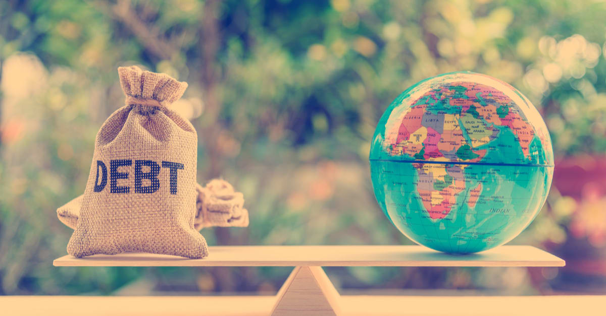Debt bag, world globe on a balance scale, depicts the governments fiscal profligacy