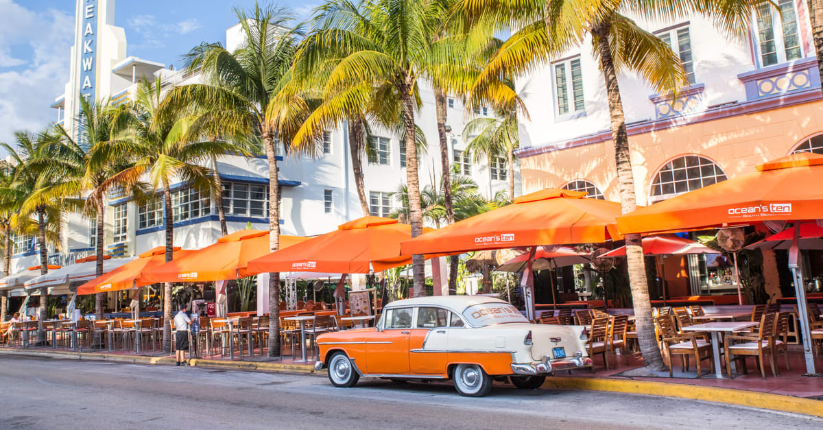 View along Ocean Drive along South Beach Miami in the historic Art Deco District with hotels, restaurant and classic car