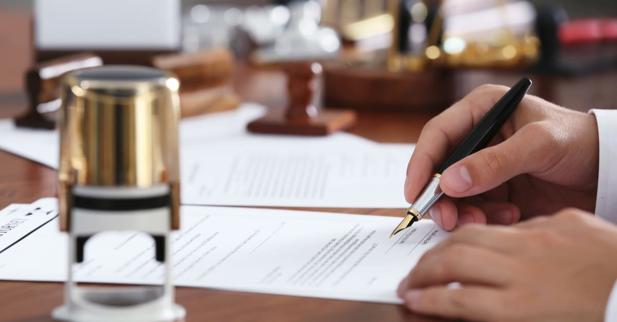 Notario Publico Notary public in office signing document