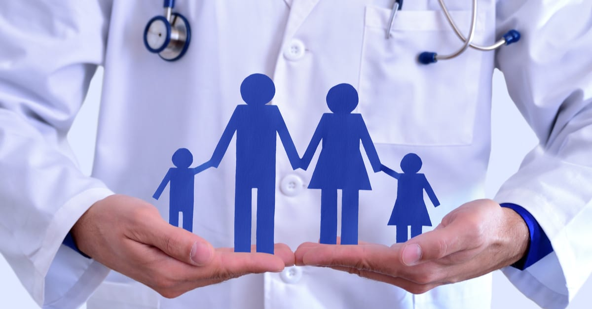Caucasian general doctor taking family cut. Concept of family health insurance.. Horizontal composition.