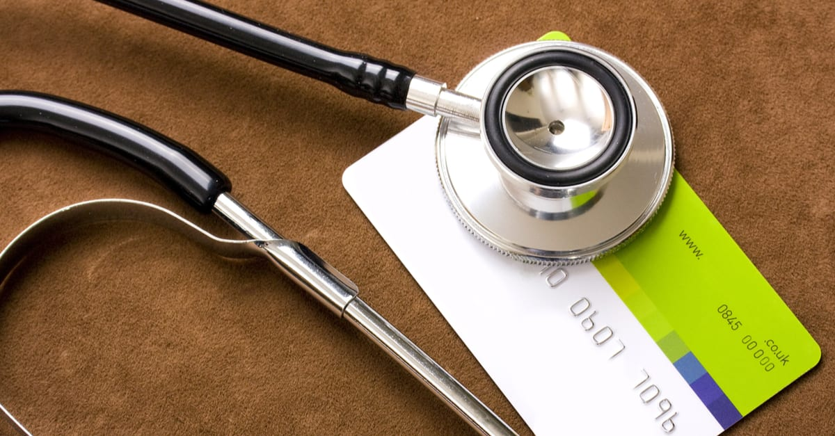 Stethoscope on a credit card