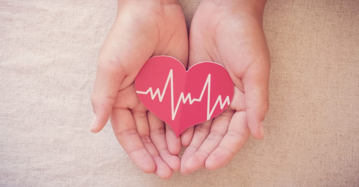 hands holding red heart with cardiogram, health care, life insurance business concept, world heart day